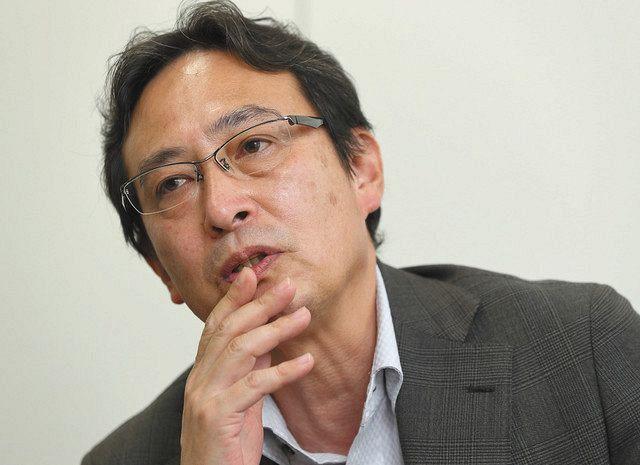 ワーカーズコープについて話す日本労働者協同組合連合会の古村伸宏理事長